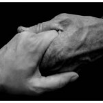 Image - Two clasping helping hands